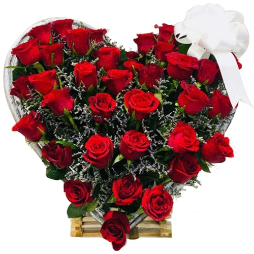 Festive Seasons Greetings 18 Heart Shaped Red Roses Arrangement