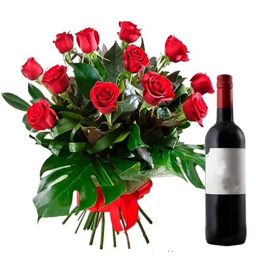 Mesmerizing 12 Red Roses with Wine on the Eve of Special Occasion