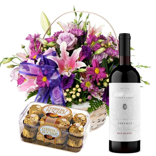 Yummy Ferrero Rocher Chocolates with Red Wine and Seasonal Flowers Hamper To
